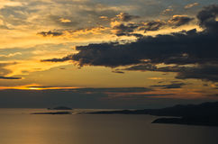 Sunset at sea, with small greek islands in background, Sithonia Royalty Free Stock Images