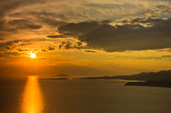 Sunset at sea, with small greek islands in background, Sithonia Stock Photography