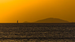 Sunset at sea, with small greek islands in background, Sithonia Royalty Free Stock Photo