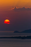 Sunset at sea, with small greek islands in background, Sithonia Royalty Free Stock Photography