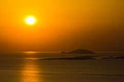 Sunset at sea, with small greek islands in background, Sithonia Royalty Free Stock Image