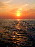 Sunset on the sea with solar path Stock Image