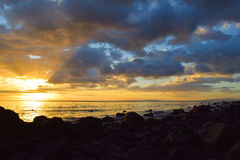 Sunset. By the sea with stones royalty free stock images