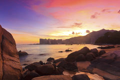 Sunset with sea stones in Hong Kong Royalty Free Stock Photo