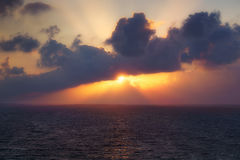 Sunset on the sea with sun rays Royalty Free Stock Images