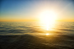 Sunset on the sea. The sun to set over the horizon reflected in the sea Stock Photos