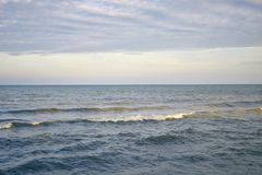 Very calm sea after the sunset. Sunset in the sea after a thunderstorm Stock Images