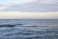 Very calm sea after the sunset. Sunset in the sea after a thunderstorm Stock Image