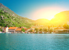 Sunset in the sea town. Sunset in the town on the sea shore with mountains around Stock Photography