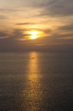 Sunset on the sea with tradition fishing boat Royalty Free Stock Photos