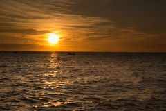 Sunset at sea. variety of colors and hues of the rising sun Stock Photos