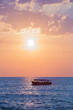 Sunset at sea with vessel at horizon Royalty Free Stock Photos