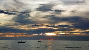 The sunset sea view and the fishing boat Royalty Free Stock Images