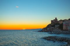 Sunset in the sea village with color huoses/ sunset/ Sun/houses/Genoa/Italy. /Europe royalty free stock photos