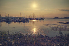Sunset at the sea. Vintage toned picture of the sea sunset Stock Photos