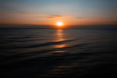 Sunset on sea with water reflection Stock Image