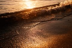 Sunset sea waves stock photography