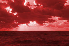 Sunset sea waves clouds. Vibrant sunset on the sea with waves on the water surface, clouds on the sky and sun rays. All this makes a specific nature pattern Stock Photos