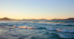 Sunset at the sea. Sea waves and sunset on the Mallorca Can Picafort, Balearic Islands, Spain Stock Image