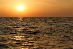 Sunset on the sea. Sea waves at sunset, the sun is reflected in the water Stock Photos