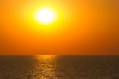 Sunset sea waves. Vibrant sunset on the sea with waves on the water surface, sun and orange sky. All this makes a specific nature pattern Royalty Free Stock Image