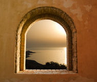Sunset on the sea through the windows Royalty Free Stock Photo