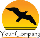 Sunset and seagull design. A company design with a sunset in the background and a bird soaring through the air Stock Images