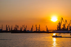 Sunset in the seaport. Cargo seaport on sunset background royalty free stock photo