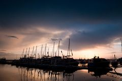Sunset in the sea port of Sochi royalty free stock image