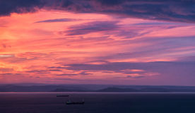 Sunset seascape. Sunset landscape with cargo ships and red clouds Royalty Free Stock Photography