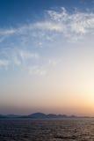 Sunset Seascape in Sardinia. Warm orange and blue sunset seascape over the mountains of sardinia, Italy stock images