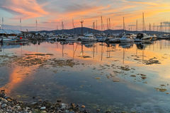 Sunset seascape with small boats at the port of Sozopol,  Bulgaria Stock Images