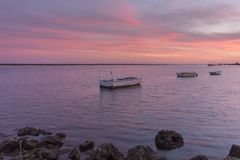 Sunset seascape view of Olhao dockyard, waterfront to Ria Formosa. Algarve Stock Images