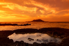 Sunset seascape and volcano Stock Image