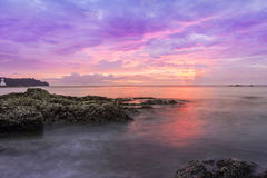 Sunset seascapes rock in water beach asia Royalty Free Stock Images