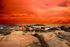 Sunset of the seashore. Sunset of the south china sea, a great span of rocks Royalty Free Stock Image