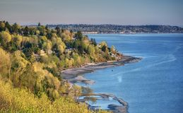 Sunset at Seattle`s Discovery Park and Puget Sound. Sunset Illuminates Spring Foliage and the Puget Sound in Seattle's Discovery Park Stock Image