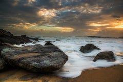 Sunset Seawaves and an empty beach Stock Photos