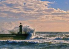 Big storm near a lighthouse in Oporto, Portugal royalty free stock images