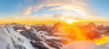 Sun setting close to Matterhorn. Sunset seen from Margherita Cabin at Monte rosa with a beautiful panoramic view over the Matterhorn Royalty Free Stock Photo
