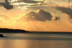Sunset seen from matala bay on the island crete Royalty Free Stock Photos