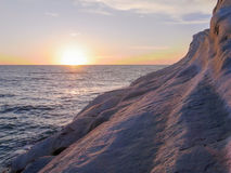 Sunset seen from the white cliff called Scala dei Turchi, near Agrigento Royalty Free Stock Photo