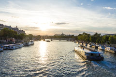 The sunset on the Seine river in  Paris. Royalty Free Stock Photos