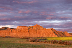 Sunset in the semi-desert Bardenas, eroded mountains, Natural Pa Stock Images