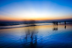 Sunset at Seminyak Beach Bali. Bali is a paradise island where you can find a fascinating snapshot of sunset beach Royalty Free Stock Photo
