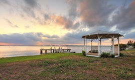 Sunset Serenity on Lake Macquarie NSW Australia. Sunset on Lake Macquarie with jetty and white lattice gazebo in view Stock Photos
