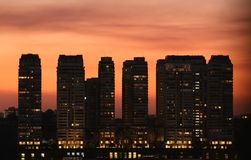 Sunset on sets of buildings. In big city Royalty Free Stock Image