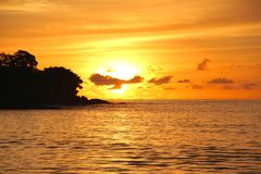 Sunset in the Seychelles with mountain and trees Royalty Free Stock Images