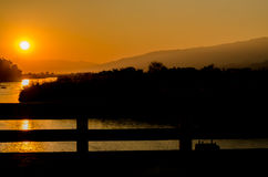 Sunset and shadow in evening. Time on river bridge Stock Image