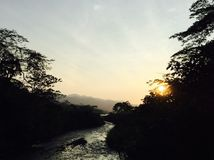 Sunset Shadows. A beatiful sunset in CostaRica casted along a river and some stock image